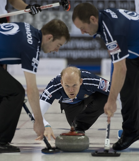 Scotland's Ewan MacDonald delivers rock to sweepers Ruairidh Greenwood, left, and Euan Byers. (Photo, Curling Canada/Michael Burns)