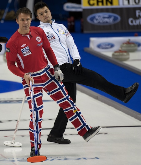 Are they dancing? Norway's Thomas Ulsrud and Japan's Tsuyoshi Yamaguchi strike a pose. (Photo, Curling Canada/Michael Burns)