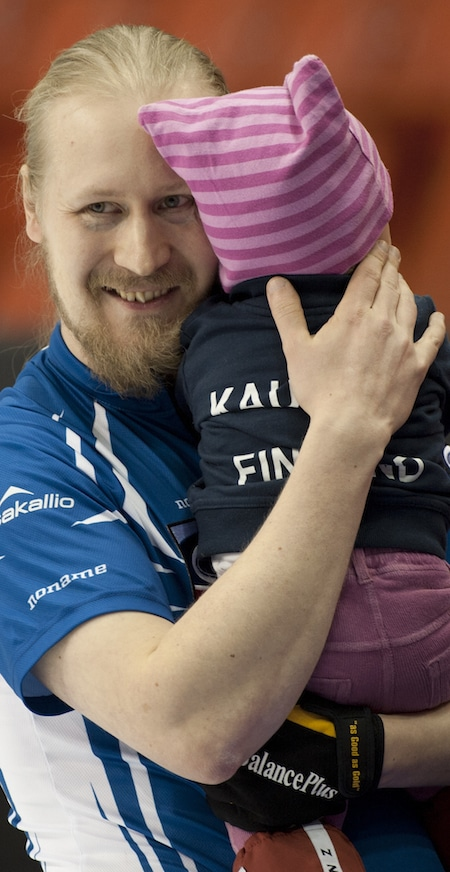 Finland's Aku Kauste celebrates his tiebreaker win with daughter Maisa. (Photo, Curling Canada/Michael Burns)