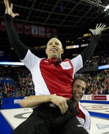 Pat Simmons is hoisted by teammate John Morris after winning the Tim Hortons Brier a year ago in Calgary. (Photo, Curling Canada/Michael Burns)