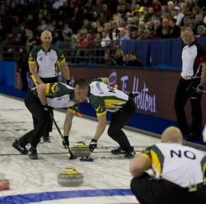Northern Ontario sweeps their final rock of the 10th end to the top four. (Photo, Curling Canada/Michael Burns Photo)