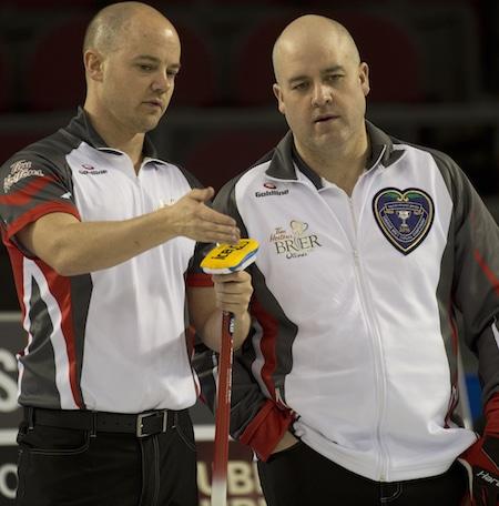 Team Northwest Territories vice-skip Chris Schille, left, and skip Jamie Koe discuss their shot options. (Photo, Curling Canada/Michael Burns)