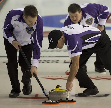 Yukon skip Bob Smallwood, top left, gives instructions to sweepers Clint Abel, left, and Scott Odian. (Photo, Curling Canada/Michael Burns