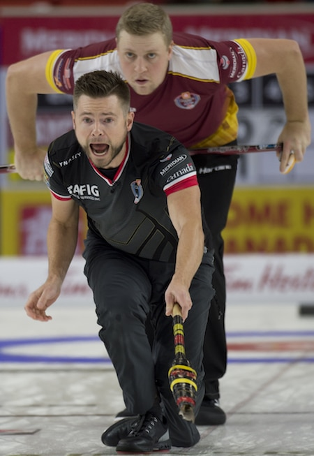 Mike McEwen calls instructions to his teammates as Colton Flasch looks on. (Photo, Curling Canada/Michael Burns)