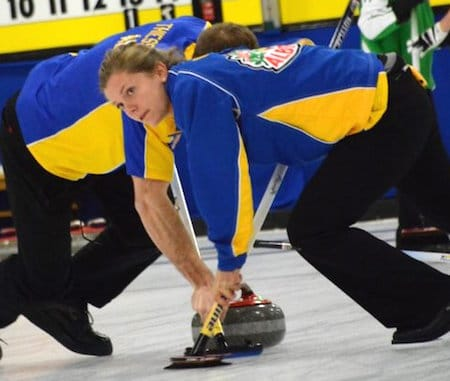 Alberta sweepers Sarah Wilkes, right, and Brad Thiessen go to work during the gold-medal game. (Photo, Curling Canada/Sonja DiMarco)
