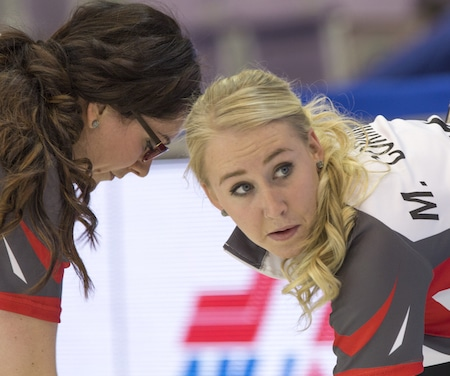 Northwest Territories third Megan Cormier, right, and second Danielle Derry in action during Friday's game. (Photo, Curling Canada/Andrew Klaver)
