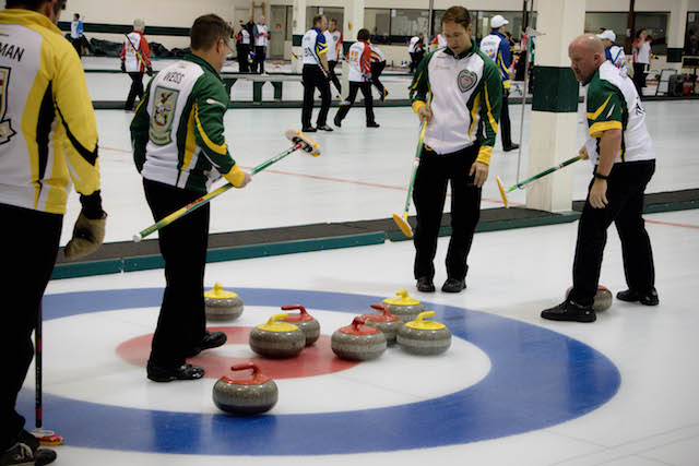 Team Northern Ontario discusses their next shot at the 2016 Travelers Curling Club in Kelowna, B.C. (Curling Canada/Jessica Krebs photo)