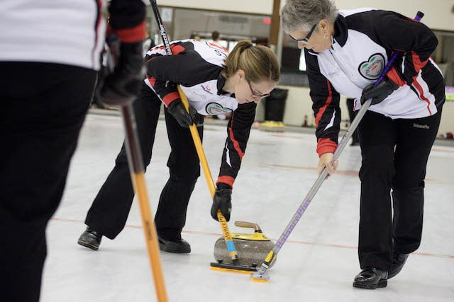 Mother-and-daughter Ontario sweepers, Lisa Jones and Susan Cully (Curling Canada/Jessica Krebs photo)