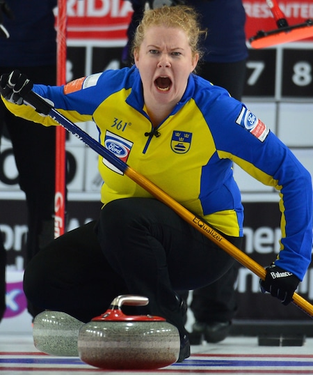 Swedish skip Margaretha Sigfridsson shouts encouragement to her teammates. (Photo, Curling Canada/Michael Burns)