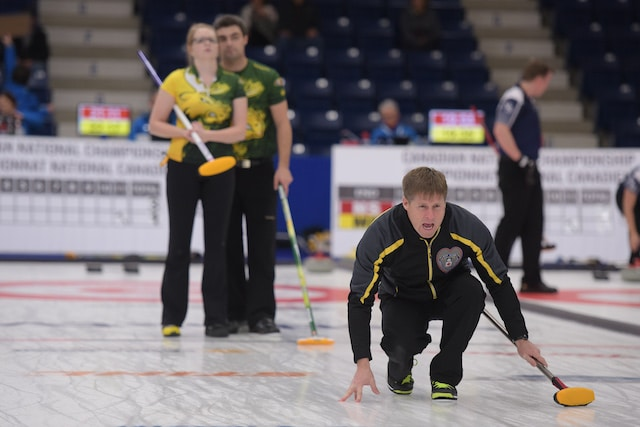 New Brunswick skip Charlie Sullivan calls the line while Northern Ontario's Megan Carr and Kory Carr follow the action during the final game of the championship round at the 2017 Canadian Mixed Curling Championship in Yarmouth, N.S. (Curling Canada/Clifton Saulnier photo)