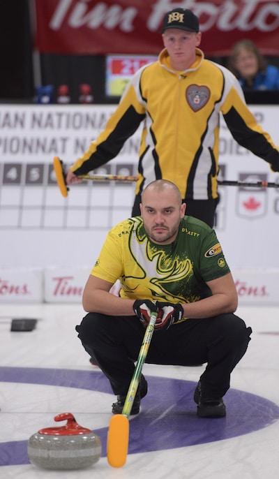 Manitoba skip Braden Calvert peers over the shoulder of Northern Ontario skip Trevor Bonot during Saturday's gold-medal game. (Photo, Curling Canada/Clifton Saulnier)