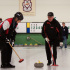 Les joueurs sur la piste dans un match ordinaire des Venerables au Club de curling et de tennis Tam Heather à Scarborough, Ont. (Photo par Andrew Lamb)