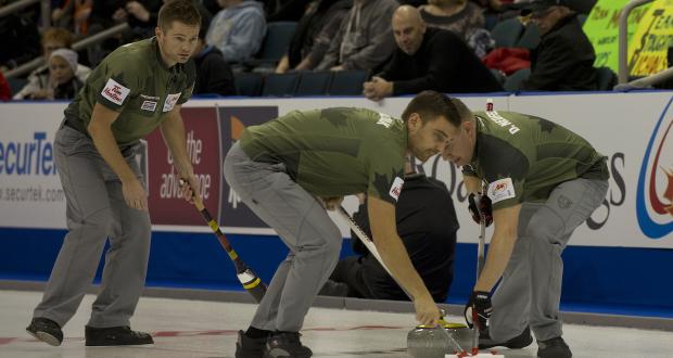 Winnipeg Mb. Tim Hortons Roar of the Rings 2013.skip Mike McEwen,lead Deni Neufeld,second Matt Wozniak.CCA/michael burns photo