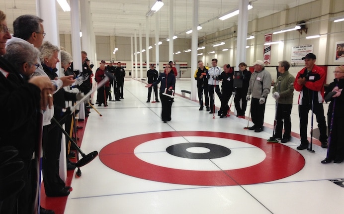 Train the Trainer leader Anna Keller leads a session on the ice at the Ottawa Curling Club (Photo courtesy Ottawa Curling Club)