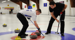 Tyler Tardi (BC) and Wayne Tuck (ON) in action at the 2015 Mixed Doubles Curling Trials (Photo Claudette Claudette Bockstael)