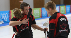 Derek Oryniak, Corryn Brown and Thomas Scoffin in the moments after winning their bronze medal on the ice in Innsbruck (Photo WCF/Richard Gray)
