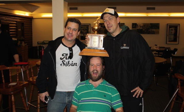"""Members of the An Sibin Pub team celebrate winning the """"Sociables Trophy"""" in the afternoon """"bar league"""" at the Royal Canadian Curling Club in Toronto. Sadly, their two-time winning streak ended when a team from The Fox and Fiddle won the third and final session of the year. (Photo Brian Chick)"""