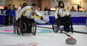 Manitoba's Dennis Thiessen delivers his rock during Draw 1 action at the 2015 Canadian Wheelchair Curling Championship (Photo Morgan Daw)