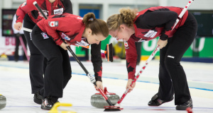 Allyson Stewart and Maureen Bonar sweep hard during action at the 2015 World Senior Curling Championships in Sochi, Russia (WCF/Céline Stucki Photo)