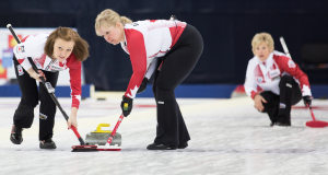 Allyson Steward and Cathy Gauthier sweep Lois Fowler's rock during action at the 2015 World Senior Curling Championships in Sochi, Russia (WCF/Céline Stucki Photo)