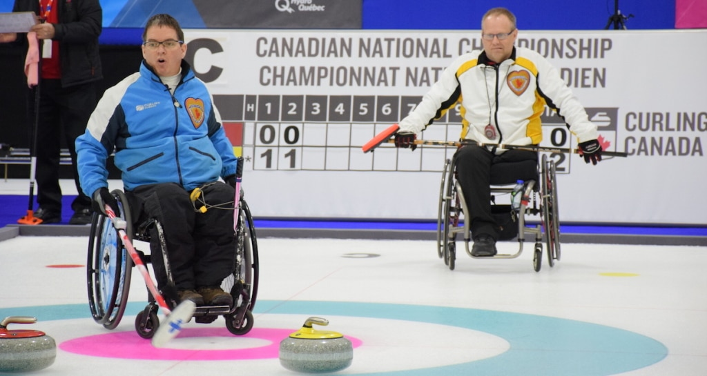 Benoit Lessard (QC) and Dennis Thiessen (MB) in action at the 2015 Canadian Wheelchair Curling Championship in Boucherville, Que. (Photo Morgan Daw)