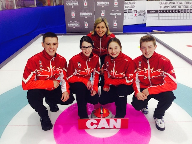 Team Canada poses on the ice with their new gear (l-r): Tyler Tardi, Mary Fay, coach Helen Radford, Karlee Burgess and Sterling Middleton (Curling Canada photo)