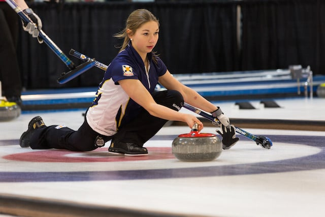 Karlee Burgess delivers her rock during competition at the 2015 Canada Winter Games (Photo CWG/Chris Leboe)