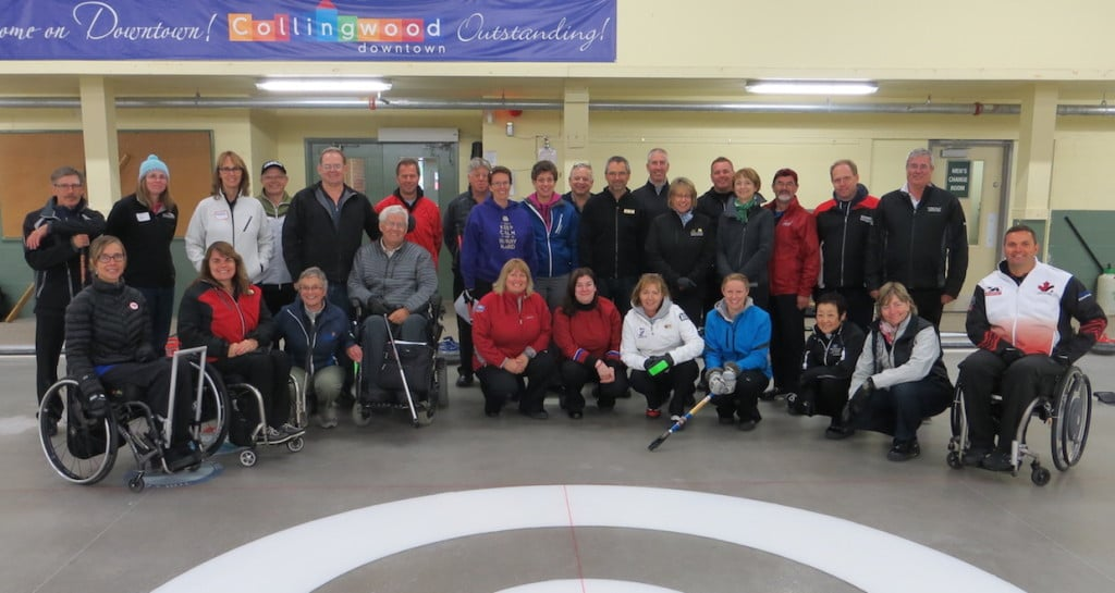 Participants in a wheelchair curling coaching session on the ice at the Collingwood Curling Club with 2014 Paralympic gold medallists Sonja Gaudet (far left) and Mark Ideson (far right) (Photo Curling Canada/Tom Ward)