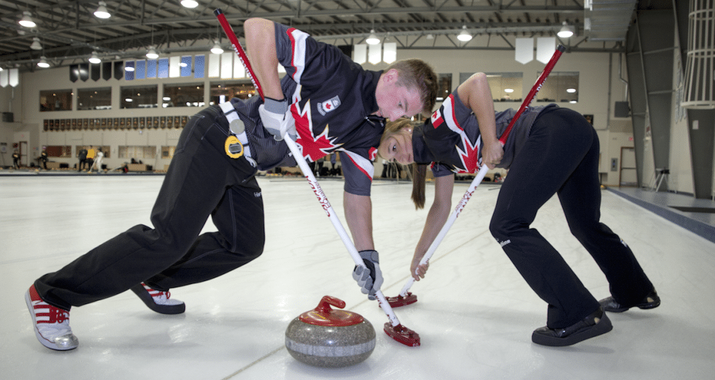 Team Canada Youth Olympians Sterling Middleton and Karlee Burgess work on sweeping technique at the National Training Centre in Edmonton, Alta. (Photo by H. Radford)