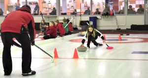A young Elmwood CC curler gets some one-on-one instruction on her delivery in the thriving youth program (Photo courtesy B. Quesnel)