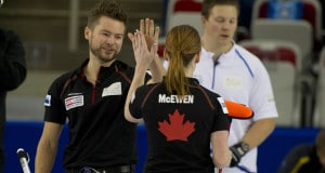 Calgary Ab,January 10, 2015.World Financial Group Continental Cup Curling.Dawn McEwen gives the hand shake to husband Mike McEwen during the mixed doubles competions at the Continental Cup Curling. michael burns photo
