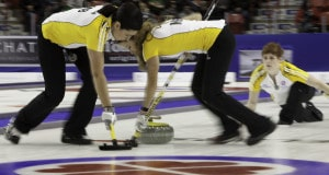 The new Team Canada, Team Manitoba, skip Jennifer Jones, third Kaitlyn Lawes, second Jill Officer, lead Dawn McEwen, alternate Jennifer Clark-Rouire and coach Wendy Morgan win the 2015 Scotties Tournament of Hearts, the Canadian Womens Curling Championships, Moose Jaw, Saskatchewan