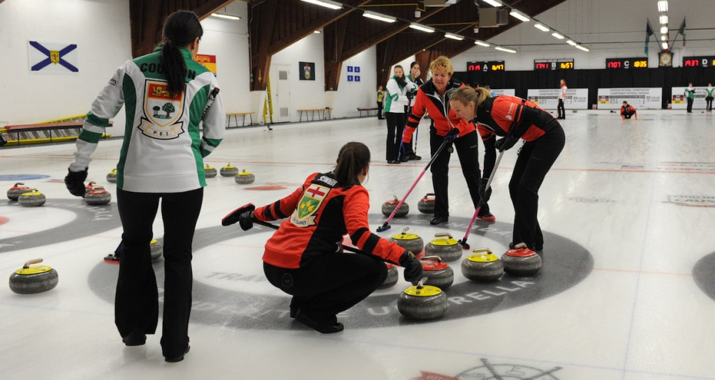 Ontario and PEI women in action in Draw 14 action at the 2015 Travelers Curling Club Championship in Ottawa (Curling Canada/Claudette Bockstael Photo)