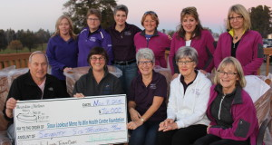 The organizing committee of the Skip to Win bonspiel presents a cheque for $76,000 to the Sioux Lookout Meno Ya Win Health Centre Foundation (Photo courtesy of Muriel Anderson)