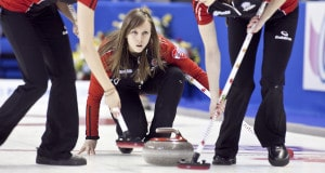 Ontario, Rachel Homan trows her rock as Alison Kreviazuk and Lisa Weagle, sweep in draw 14, at the 2013 Scotties Tournament of Hearts, February 16-24, Kingston Onatrio, The Canadian Womans Curling Championship.
