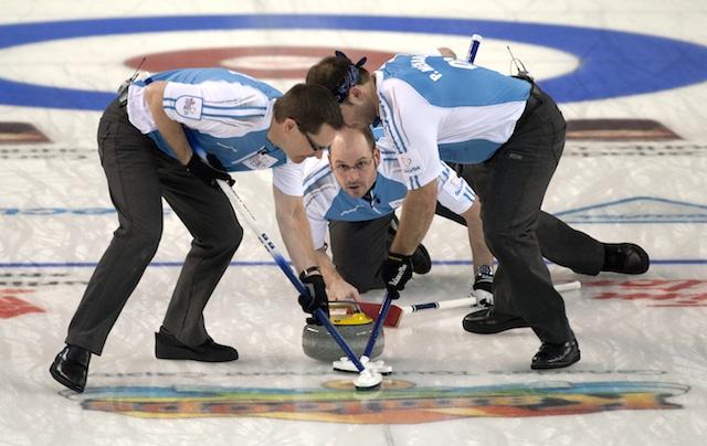 Kamloops B.C.Mar8_2014.Tim Hortons Brier.Quebec skip Jean-Michel Menard,Manitoba,lead Phillipe Menard,second Eric Sylvain.CCA/michael burns photo
