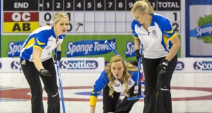 Team Alberta skip Chelsea Carey trows her rock as second Jocelyn Peterman and lead Laine Peters,  sweep in draw eleven action at the 2016 Scotties Tournament of Hearts, the Canadian Womens Curling Championships, Grande Praire, Alberta