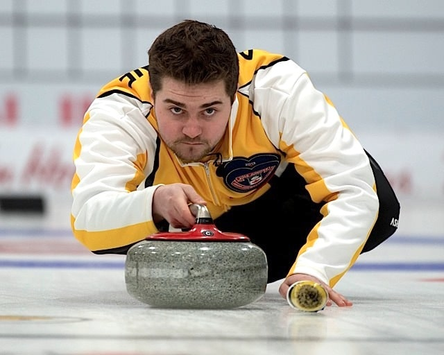 Stratford Ont.Jan 31 2016.Canadian Junior Curling Championship.Manitoba skip Matt Dunstone delivers his stone during his 11-4 victory over Northern Ontario.Dunnstone captures his second Canadian jr. Curling Championship. michael burns photo