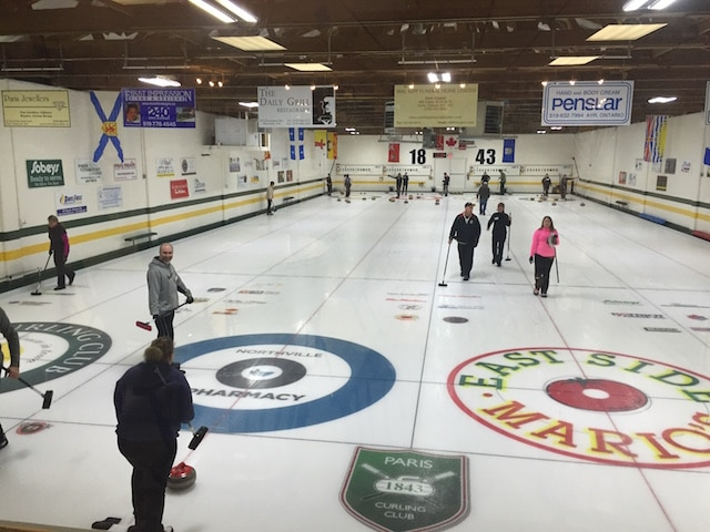 New curlers get into the action at the Paris Curling Club (Photo by Tim Risebrough)
