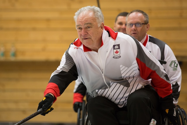 Skip Jim Armstrong focuses on his shot at the 2016 World Wheelchair Curling Championship in Lucerne, Switzerland (WCF/Céline Stucki)