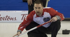Ottawa Ont.Mar 9; 2016.Tim Hortons Brier.N.L. skip Brad Gushue (foreground)  studies the incoming stone as Team Canada skip Pat Simmons checks the stones line.Gushue defeats Simmons 7-3 in 9 ends.  michael burns photo