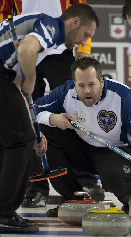 Nova Scotia skip Jamie Murphy instructs sweeper Scott Saccary during Friday's pre-qualifying game. (Photo, Curling Canada/Michael Burns)