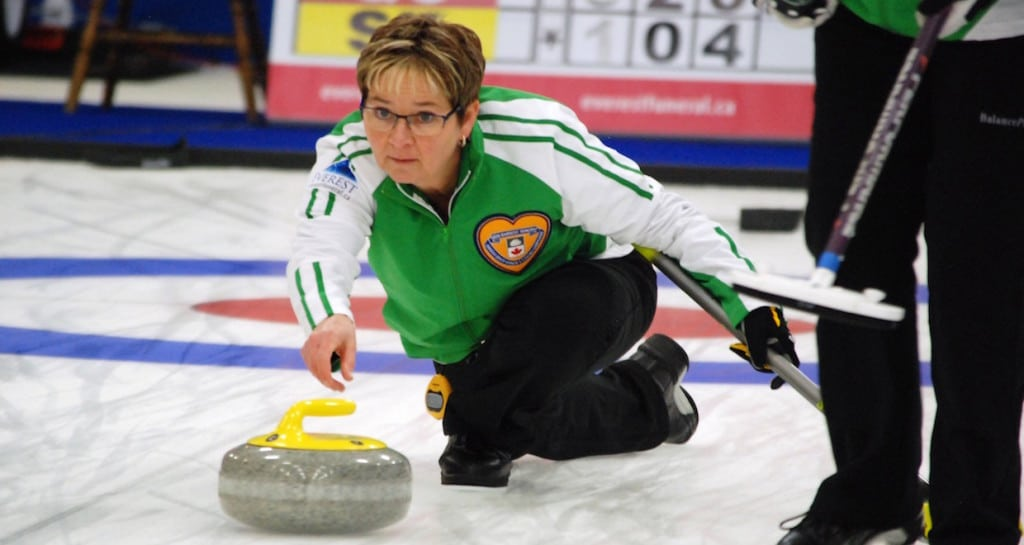 Sherry Anderson of Saskatchewan delivers her rock in a 6-5 win over Alberta to remain undefeated at the 2016 Canadian Seniors Curling Championship (Curling Canada/Mike Lewis photo)