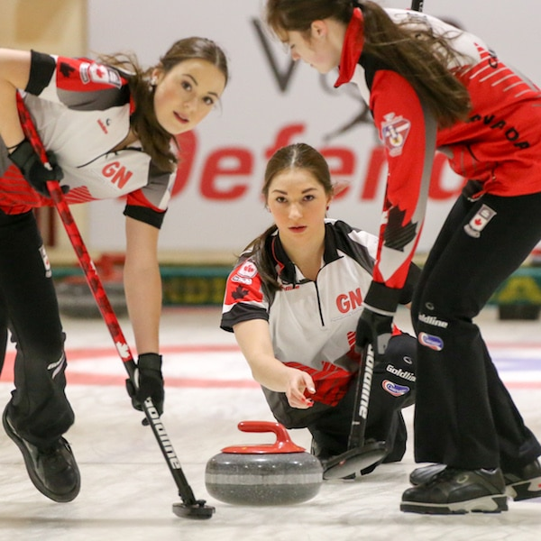 Team Canada lead Janique LeBlanc and third Kristin Clarke get ready to sweep second Karlee Burgess's rock during the Gold Medal Game of the 2016 World Junior Curling Championships in Taarnby, Denmark (WCF/Richard Gray photo)