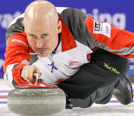 Kevin Koe delivers shot during win over Finland Saturday in Basel, Switzerland. (Photo, World Curling Federation)