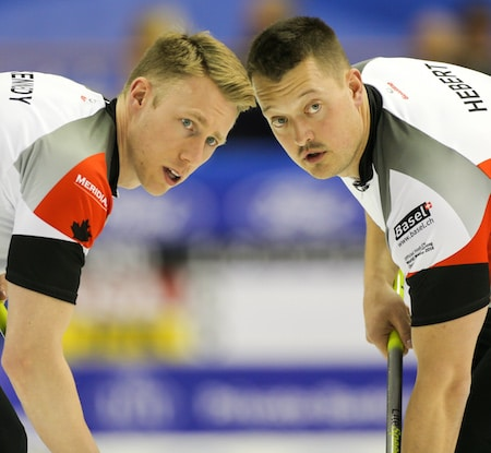 Team Canada's Marc Kennedy, left, and Ben Hebert look for instructions. (Photo, World Curling Federation/Céline Stuckli)