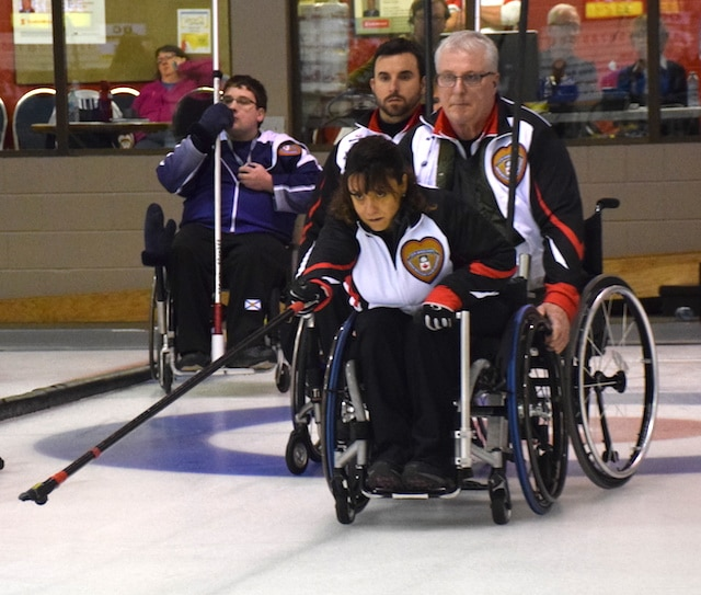 Ontario skip Colinda Joseph delivers her rock at the Callie Curling Club in Regina during the 2016 Canadian Wheelchair Curling Championship (Curling Canada/Morgan Daw photo)