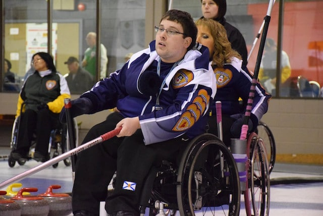 Team Nova Scotia second Keith Williams watches his rock move down the ice at the 2016 Canadian Wheelchair Curling Championship in Regina (Curling Canada/Morgan Daw photo)