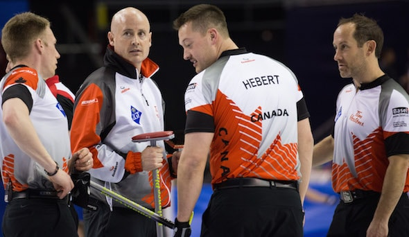 Team Canada, from left, Marc Kennedy, Kevin Koe, Ben Hebert and Brent Laing, take a break during Wednesday's loss to Sweden. (Photo, World Curling Federation/Richard Gray)