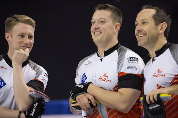 From left, Team Canada's Marc Kennedy, Ben Hebert and Brent Laing take a break from the pressure of Friday night's game. (Photo, World Curling Federation/Céline Stucki)
